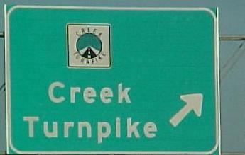 A sign marking the entrance to the Creek Turnpike near Tulsa.
