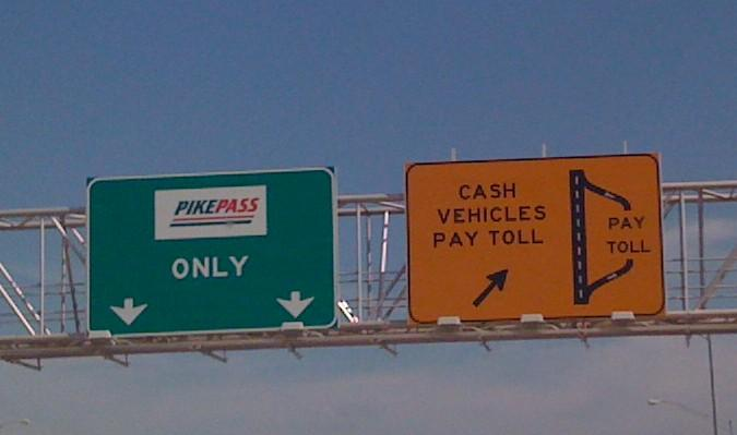 Signs on the Creek Turnpike telling motorists it is time to pay.