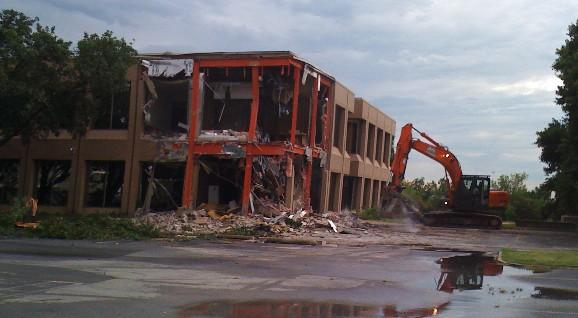 The Graves Office Building at 51st and Lewis comes down as part of the I-44 widening project.