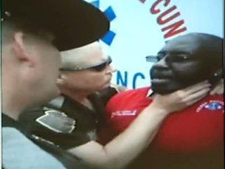 State Trooper Daniel Martin restrains EMT Maurice White, Jr.