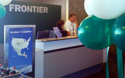 Balloons welcome travelers are Frontier Airlines resumes Tulsa service.