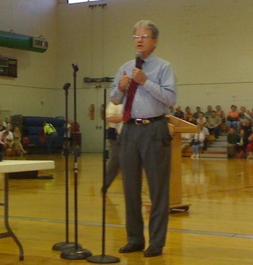Senator Tom Coburn listens to a question at a Broken Arrow town hall meeting.