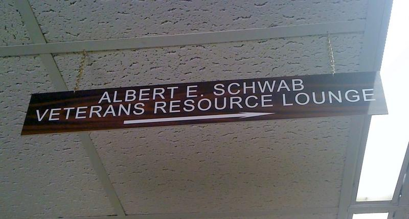 A sign hangs from the ceiling title marking the new Veterans Center on the TU campus.
