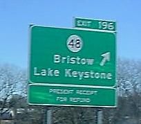 A sign marks the Bristow exit on the Turner Turnpkike.