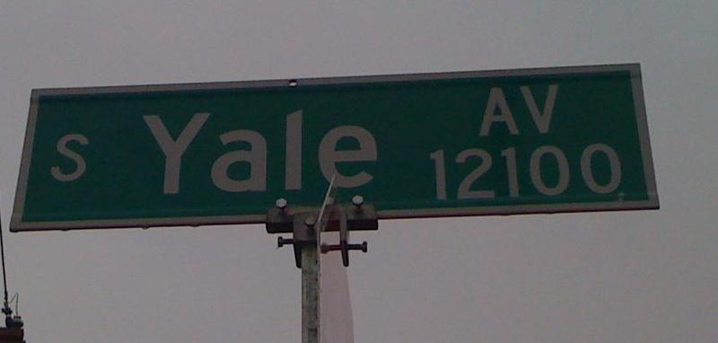 A street sign marks the intersection at 121st and South Yale Avenue.