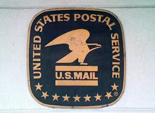 The Post Office sign on the side of the the now closed Whittier Square Post Office location.