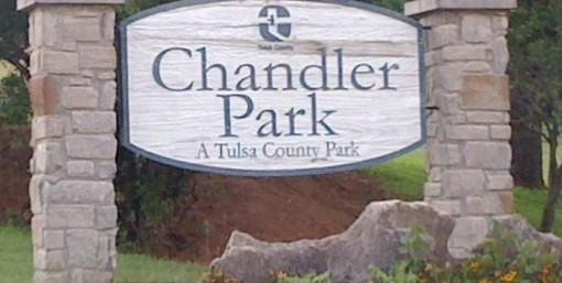 The welcome sign at the foot of the hill at Tulsa County's Chandler Park. The plane crashed on top of the hill.
