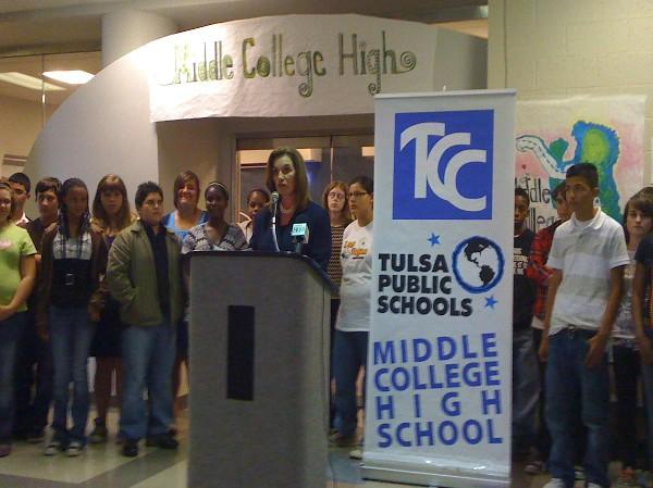 TCC's Dr. Sandra Massey addressed family and media at Tulsa Middle College High announcement.