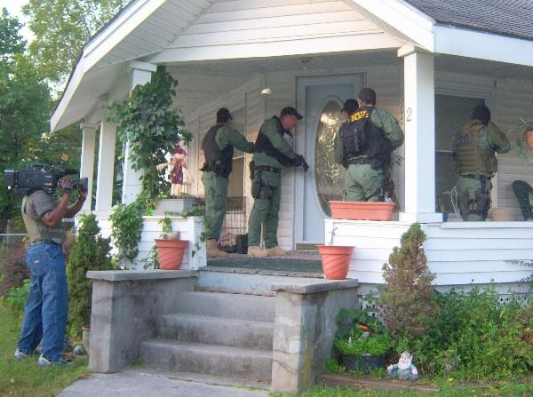 Agents raid a home in Miami.