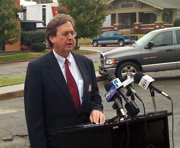 Dewey Bartlett meets with reporters across the street from his downtown office.