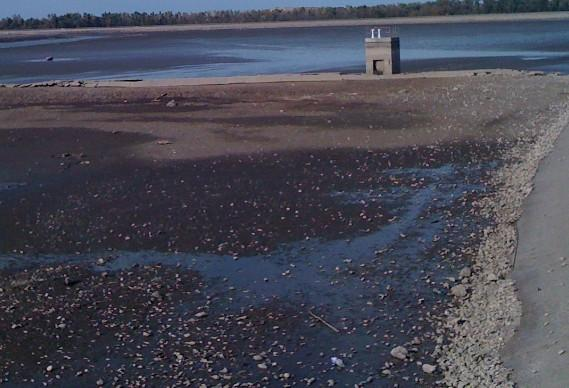 Dry ground is visible as Lake Yahola is drained for $800K renovations.