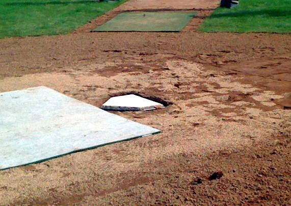 Home plate is installed at the new downtown baseball stadium.