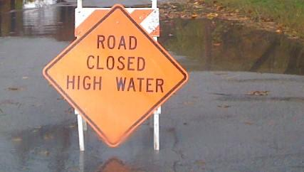 Numerous roads, like this one in Bixby, were closed by swift rising water.