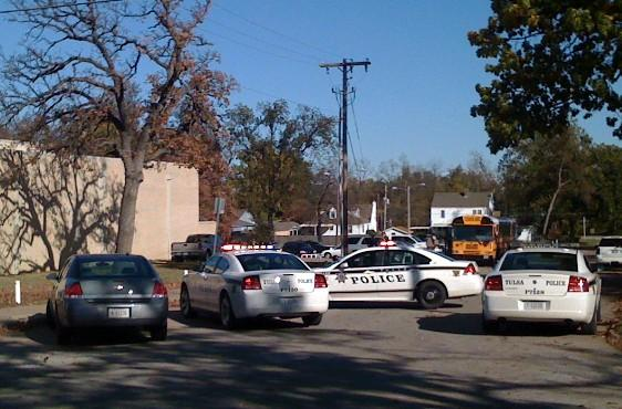 Tulsa Police cars block the street in front of Webster High School.