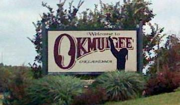 "The ""Welcome to Okmulgee\"" sign on northbound Highway 75."