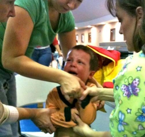 A Tulsa tot gets his shot at an earlier vaccination clinic in Tulsa.