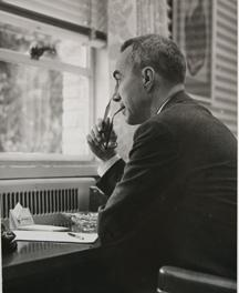 In an undated photo, Ben Henneke looks out his office window on the TU campus.
