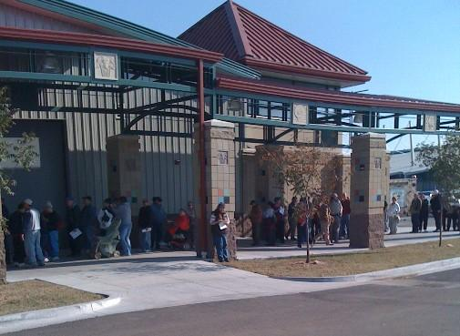 People line-up outside the Fairground's Exchange Center in Tulsa for H1N1 vaccinations.