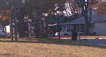 A fire truck sets in front of a home that caught fire overnight in Tulsa.