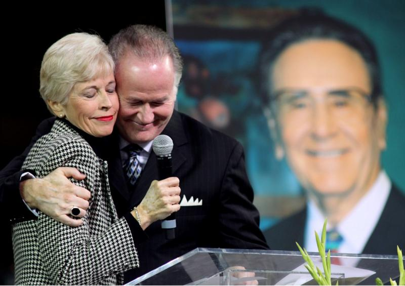 Roberta Potts and Richard Roberts share a tender moments as the eulogize their father, Oral Roberts.