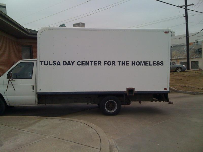 A truck sets outside the Day Center's loading dock where a catered luncheon was brought into the homeless.