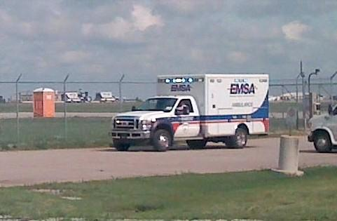 An EMSA ambulance rushes a victim to the hospital during today's airport drill.