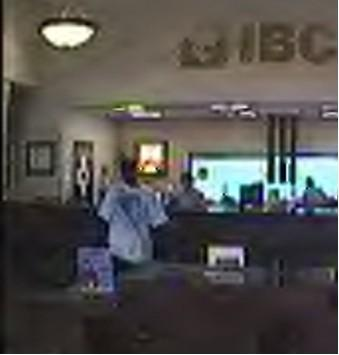 A hidden camera snaps a picture of the bank robber.