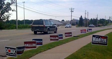 Political signs line the streets as Oklahomans head to the polls