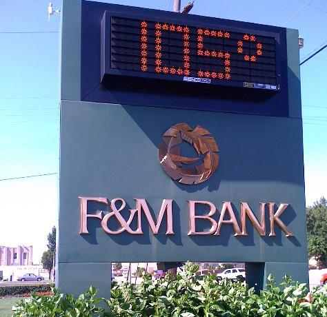 The sign in front of the F & M Bank at 13th and South Harvard