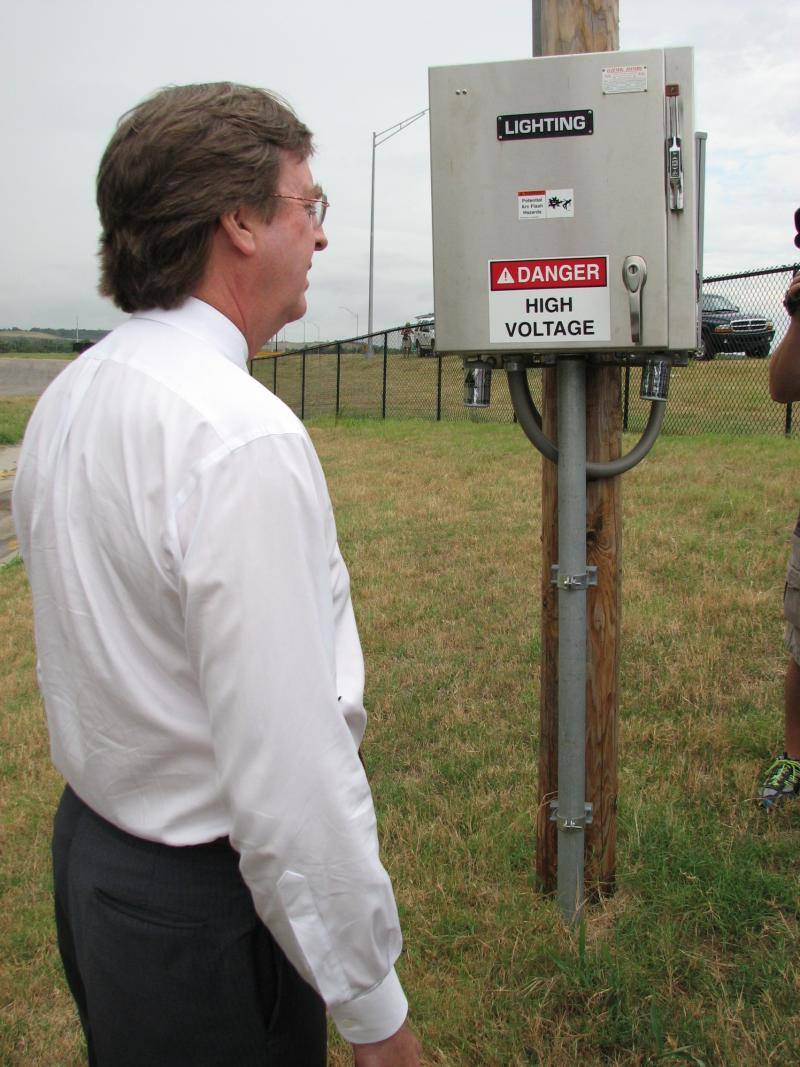 Mayor Bartlett with circuit control box for highway lights