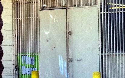 The doors are padlocked at the Zeba #-2 Food Mart, where the fatal robbery attempt took place.