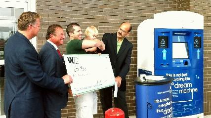 Check was presented to Eric Hurd, outside of the 71st and Sheridan Reasor's.