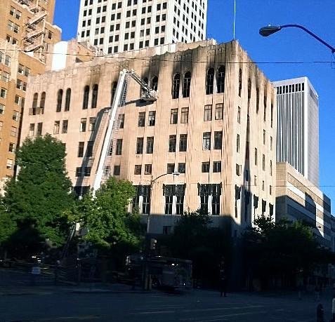 Smoke scars the window of the Tulsa Club.