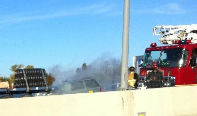 Smoke fills the air after an SUV slams into a trailer on Highway 169.