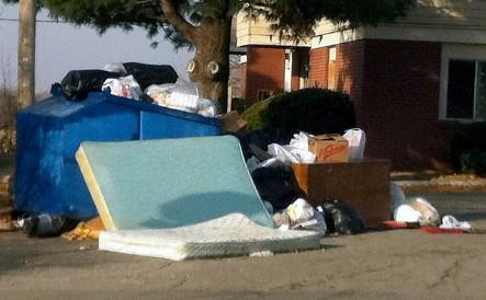 Trash piles up at the Somerset East Apartment Complex near 21st and 137th East Avenue.