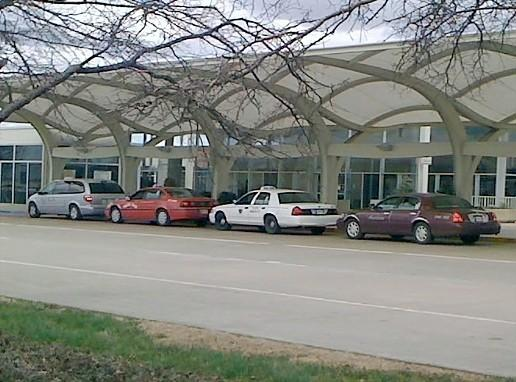Taxis await passengers at the Tulsa International Airport