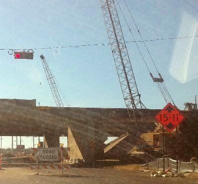 Crews bring down old overpass