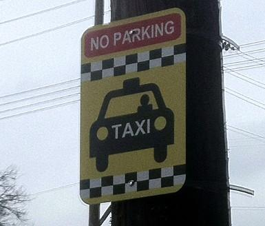 The Taxi Cab stand sign at 18th and Boston.