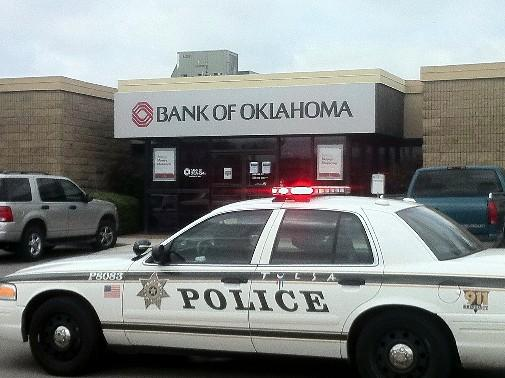 Tulsa Police car parked outside of the BOK location at I244 and West 33rd.