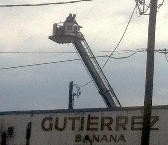 The Tulsa Fire Department uses a snorkel truck to look down on the damage.