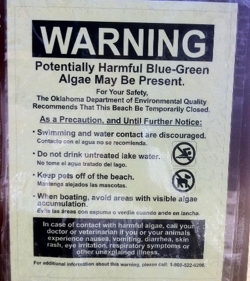 Algae Warning sign posted on Grand Lake Beach