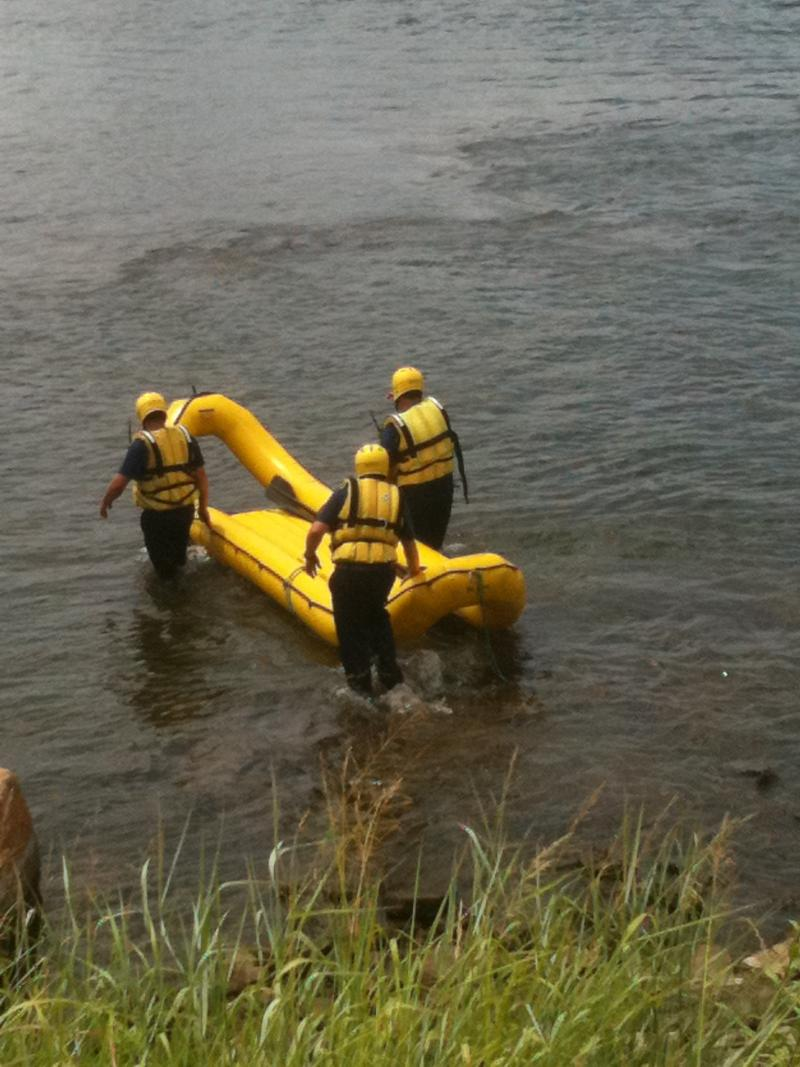 "The Tulsa Fire Department uses a ""banana boat\"" to get to the stranded family."