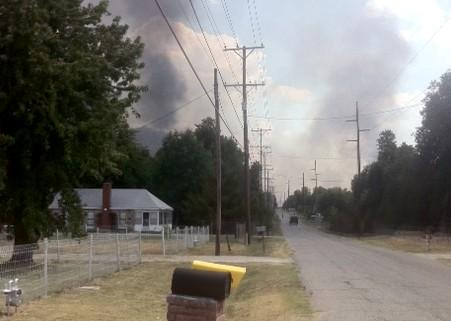 Smoke and flames approach the quiet Golden Hills Neighborhood in Turley.
