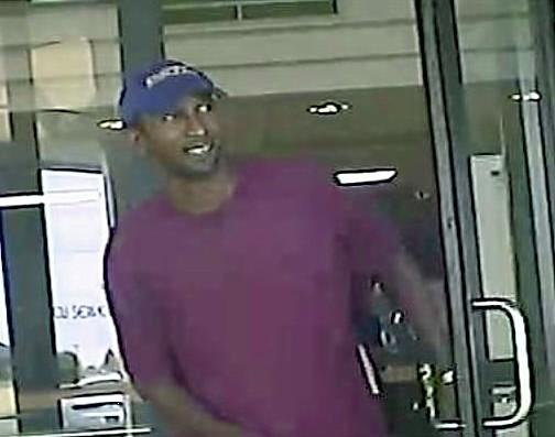 Picture of suspect leaving the credit union.