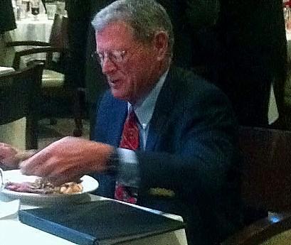 Senator Inhofe eats breakfast before speaking at the Tulsa Press Club.