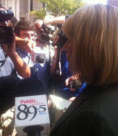 Federal Prosecutor Jane Duke talks with reporters outside the federal court house.