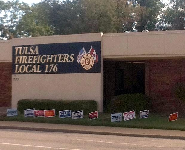 campaign signs are in front of the the Tulsa Fire Fighter's Union Hall