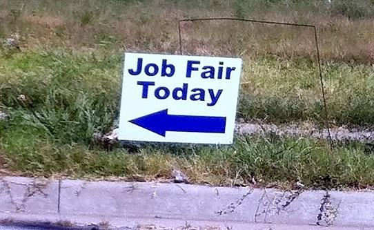 Sign directs people to Job Fair