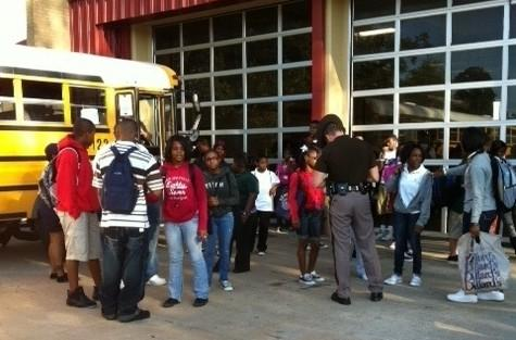 Students give information to a Highway Patrol Trooper following a school bus wreck.