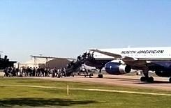 Troops board a charter at the Tulsa Air Guard Base.
